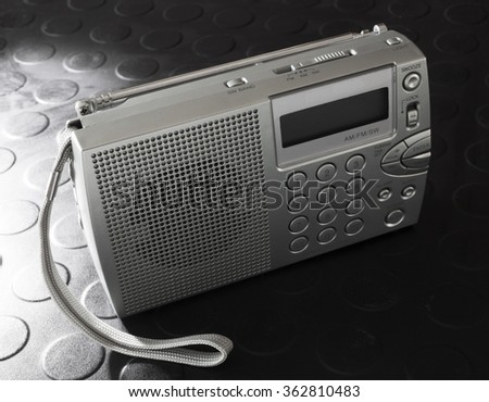 Portable battery powered radio that picks up radio stations and shortwave broadcasts - stock photo