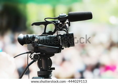 portable camera with a blurred background people - stock photo