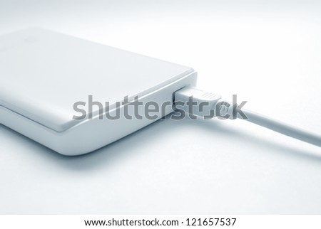 Portable external hard drive with mini USB connection - stock photo