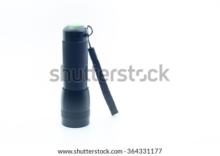 Portable flashlight or torchlight used for emergency and outdoor activity like camping isolated on white. - stock photo