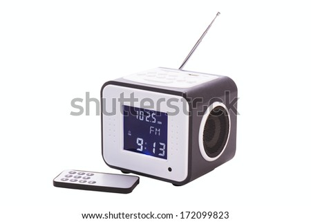 Portable radio receiver with alarm, card-reader, amplifier,  remote control and MP3 player isolated on a white background - stock photo