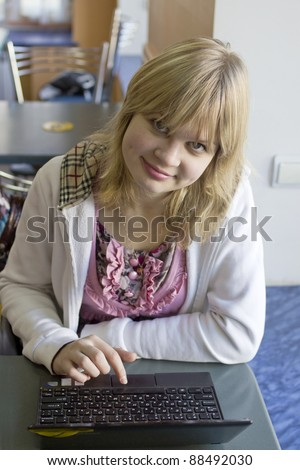 Portait of a girl with notebook - stock photo