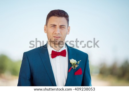 Portait of a young handsome man in suite. Close up of a gorgeous guy, outdoors - stock photo
