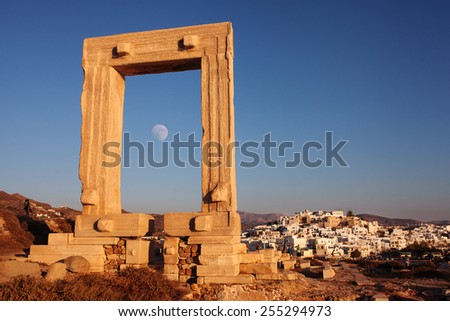 Portara gate with moon and city of Naxos, Greece. - stock photo