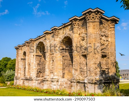 Porte Mars, an ancient Roman triumphal arch in Reims, France. - stock photo