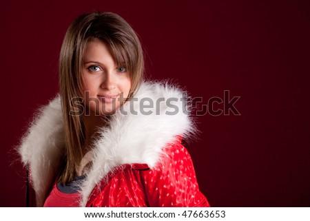 Portfait of beautiful woman wearing hooded winter red jakcet - stock photo