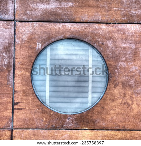 porthole in the wood. Processed for hdr tone mapping effect. - stock photo
