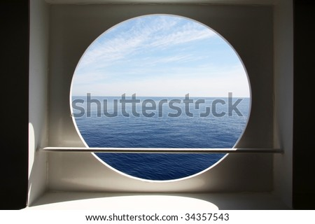 Porthole of a ocean liner - stock photo