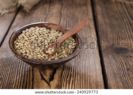 Portion of brown Lentils (detailed close-up shot) - stock photo