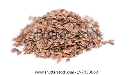 Portion of brown Linseeds isolated on pure white background - stock photo