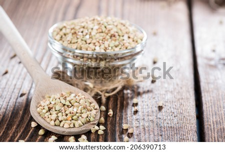 Portion of Buckwheat on a wooden spoon (close-up shot) - stock photo