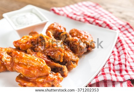 Portion of buffalo chicken wings - stock photo