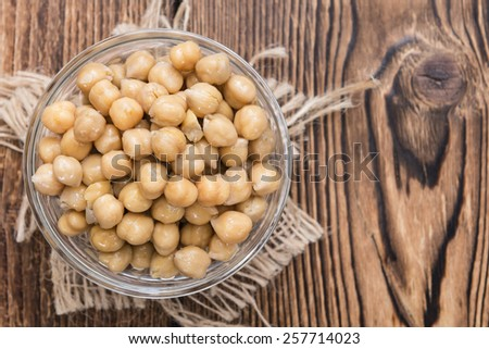 Portion of Chick Peas (Canned) on old wooden background - stock photo