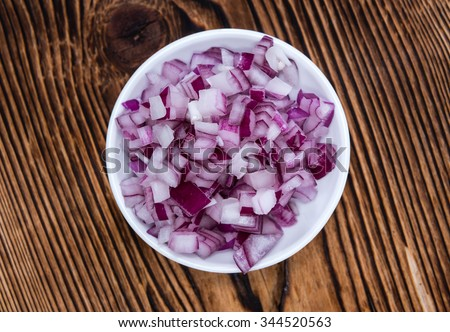 Portion of diced Red Onion (detailed close-up shot) - stock photo