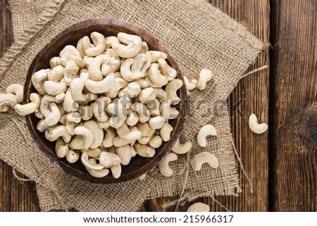 Portion of dried Cashew Nuts (detailed close-up shot) - stock photo