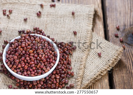 Portion of dried red beans on wooden background (close-up shot) - stock photo