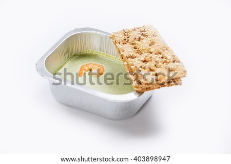 Portion of food in the container isolated on white - stock photo