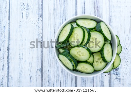 Portion of fresh and healthy Cucumbers (close-up shot) - stock photo