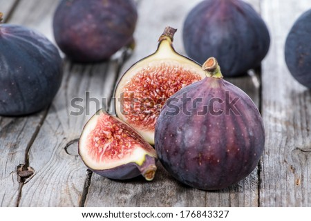 Portion of fresh Figs on vintage wooden background - stock photo