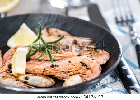 Portion of fresh fried Shrimps in a vintage pan - stock photo