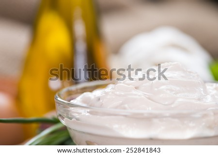 Portion of fresh homemade Aioli dip on wooden background - stock photo