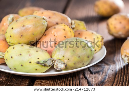 Portion of fresh Prickly Pears on wooden background (close-up shot) - stock photo