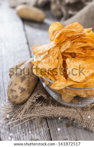 Portion of fried Potato Chips with Paprika powder - stock photo
