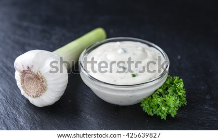 Portion of Garlic Sauce on a slate slab (selective focus; close-up shot) - stock photo