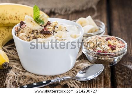 Portion of homemade Banana Yogurt with fresh fruits and honey - stock photo