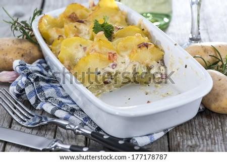 Portion of homemade Potato Gratin (close-up shot) - stock photo