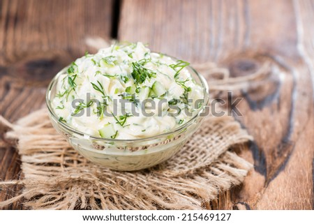 Portion of homemade Sauce Remoulade (close-up shot) on wooden background - stock photo