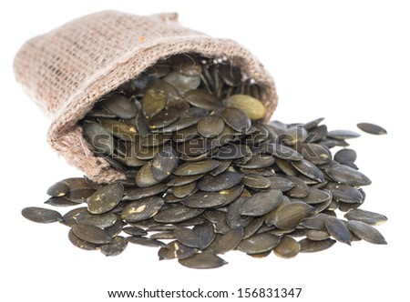 Portion of isolated Pumpkin Seeds (on white background) - stock photo