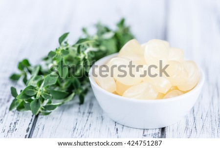 Portion of Menthol Candies (close-up shot; selective focus) on wooden background - stock photo