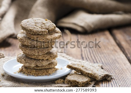 Portion of Oat Cookies (close-up shot) on wooden background - stock photo
