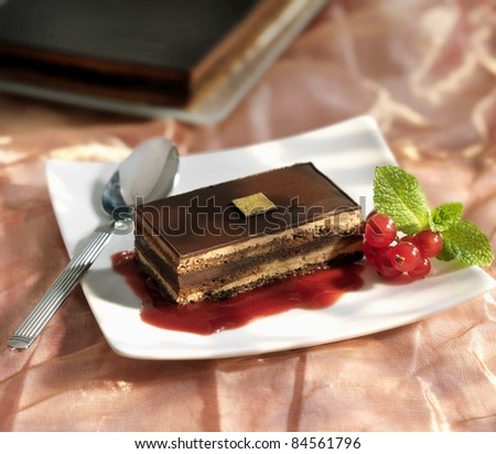 Portion of Opera with redcurrant puree - stock photo