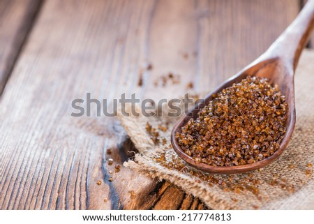 Portion of Original Smoked Salt on wooden background - stock photo