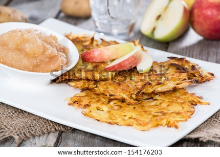 Portion of Potato Fritters on vintage grey wooden background - stock photo