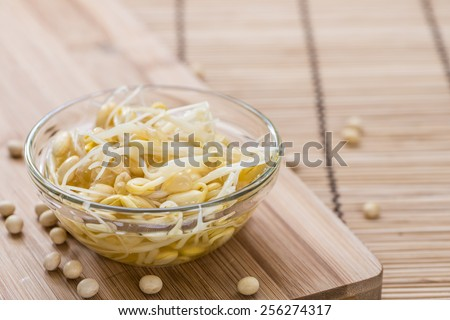 Portion of preserved Soy Sprouts (on wooden background) - stock photo