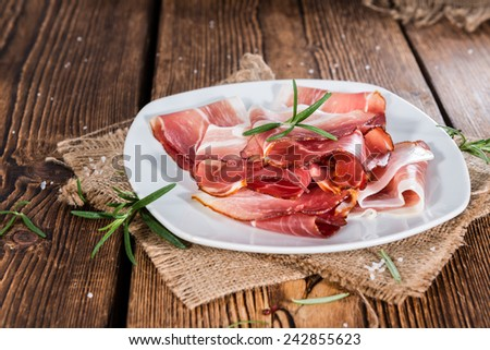 Portion of Sliced Ham with fresh herbs (close-up shot) - stock photo