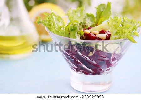 Portion salad with beetroot and pine nuts - stock photo