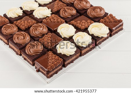 Portioned chocolate cake on white background. Catering concept. Shallow focus - stock photo