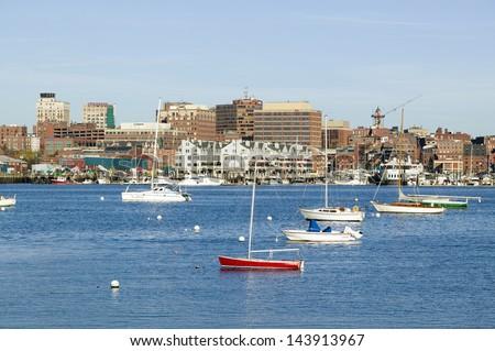 Portland Harbor boats with south Portland skyline, Portland, Maine - stock photo