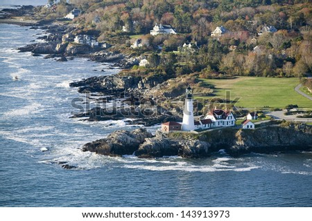 Portland Head Lighthouse and coastline in Cape Elizabeth, Maine - stock photo