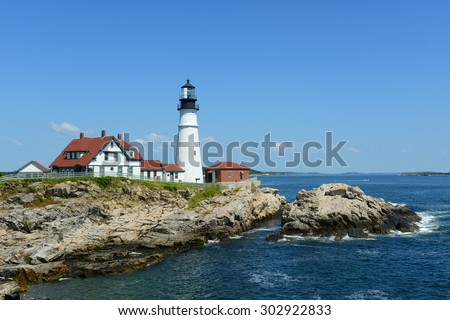 Portland Head Lighthouse and keepers' house in summer, Cape Elizabeth, Maine, USA - stock photo