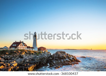 Portland Head Lighthouse at Fort Williams, Maine at sunrise over the Atlantic Ocean - stock photo
