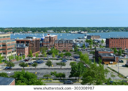 PORTLAND, ME - AUG 24: Portland Old Port is filled with 19th century brick buildings and is now the commercial center of the city on August 24th, 2014 in Portland, Maine, USA. - stock photo