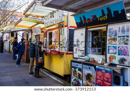 PORTLAND, OR - FEBRUARY 2, 2016: Food trucks and carts in downtown PDX offer lunch and other meails for inexpensive prices near major office buildings. - stock photo