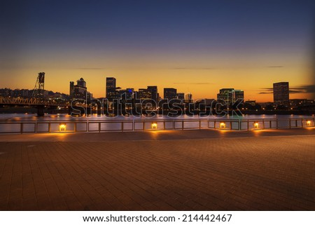 Portland, Oregon city skyline panorama with Hawthorne bridge. Colorful sunset sky and light reflection on the Willamette river. - stock photo