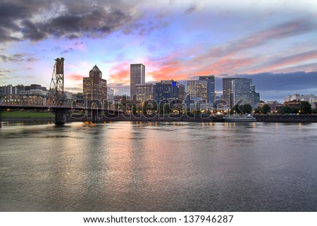 Portland Oregon Downtown City Skyline with Historic Hawthorne Bridge Across Willamette River at Sunset. Best for smaller scale. - stock photo