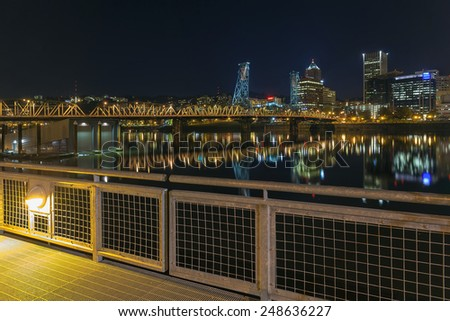 Portland Oregon Downtown Skyline and Hawthorne Bridge View from Eastbank Esplanade at Night - stock photo